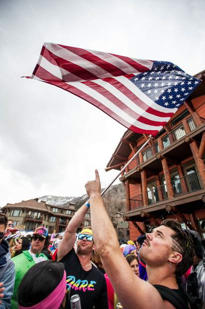 Partiers wave their flag at the Aspen Highlands Alehouse for the closing day party on Sunday.