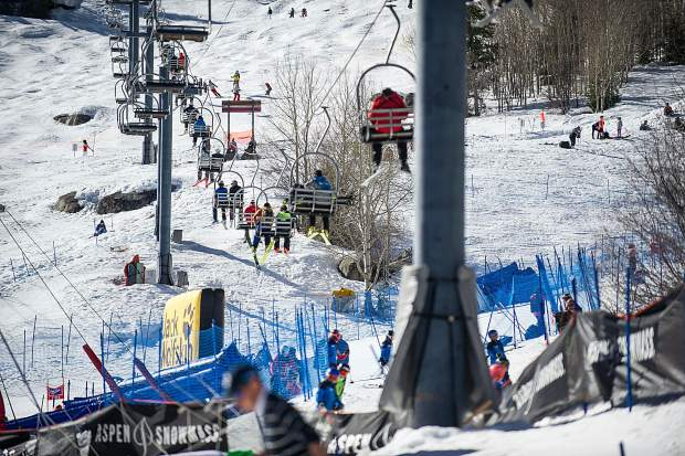 Skiers and snowboarders ride lift 1A up Aspen Mountain during the World Cup Finals this past March in Aspen.