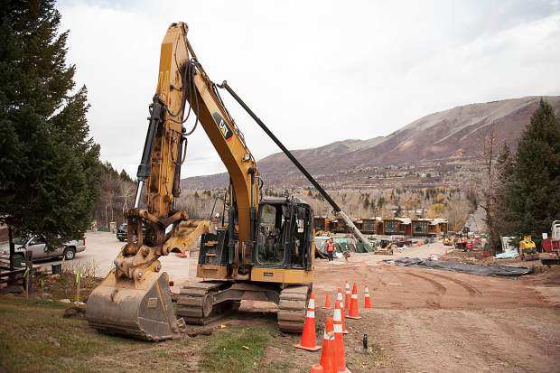Construction workers continue to work on Aspen Street on Thursday afternoon that leads up to lift 1A.