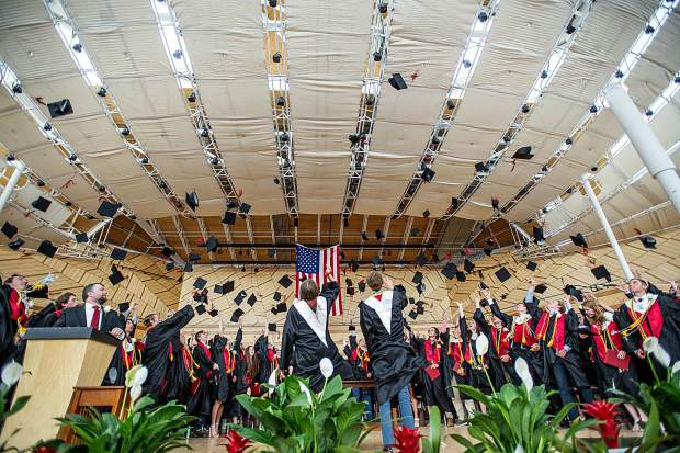 The 2018 Aspen High School graduating class tosses their hats into the air at their graduation ceremony on Saturday.