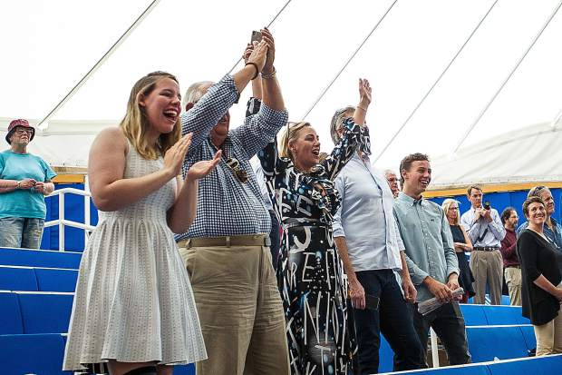 A family cheers at the Aspen High School graduation ceremony on Saturday at the Benedict Music Tent.