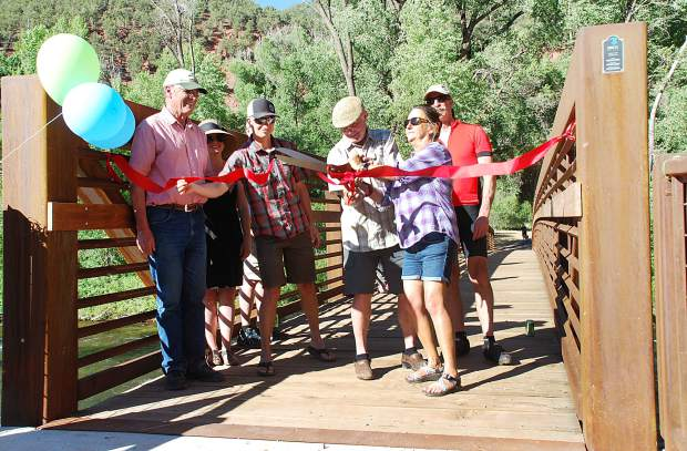 Pitkin County Open Space and Trails hosted a cookout and ribbon cutting at Lazy Glen Subdivision on June 20 to celebrate the opening of the Lazy Glen Bridge over the Roaring Fork River. The span gives the roughly 100 households at Lazy Glen access to open space and the Rio Grande Trail on the opposite side of the river. Doing the honors, from left, were Commissioner Steve Child, Lindsey Utter and Gary Tennenbaum with Open Space and Trails, OST Board Chairman Graeme Means, BOCC Chairwoman Patti Clapper and Commissioner George Newman.