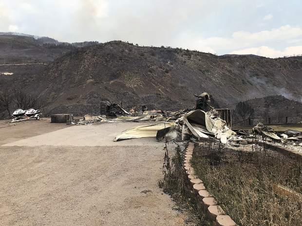 Cleve and Kerry Williams' remains of their house that burnt down in Missouri Heights in the early morning hours on Thursday from the Lake Christine Fire.