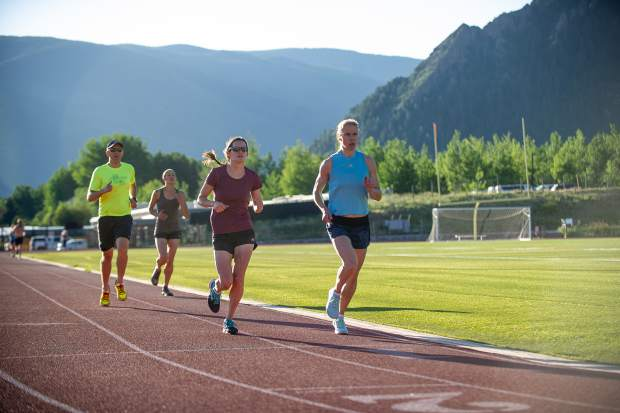Runners running on the Aspen High School track the morning of July 3, 2018.