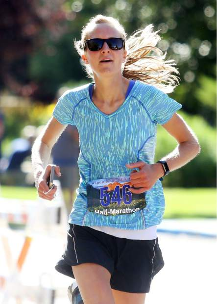 Carbondale's Noel Malcomson approaches the finish of the half marathon for the Aspen Valley Marathon on Saturday, July 14, 2018, in Basalt. (Photo by Austin Colbert/The Aspen Times).