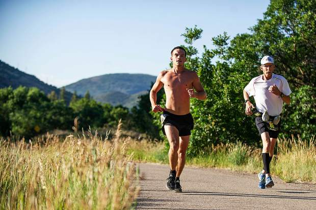 Racers compete in the Aspen Valley Marathon on the Rio Grande Trail from Aspen to Basalt on Saturday morning.