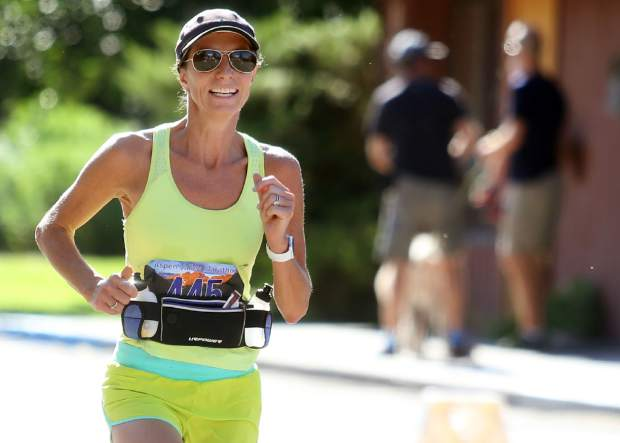 Aspen's Ashley Connolly approaches the half marathon finish for the Aspen Valley Marathon on Saturday, July 14, 2018, in Basalt. (Photo by Austin Colbert/The Aspen Times).