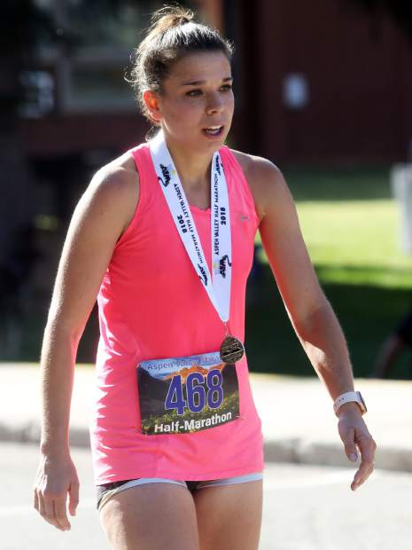 Women's half marathon winner Christie Foster catches her breath after crossing the finish line for the Aspen Valley Marathon on Saturday, July 14, 2018, in Basalt. (Photo by Austin Colbert/The Aspen Times).