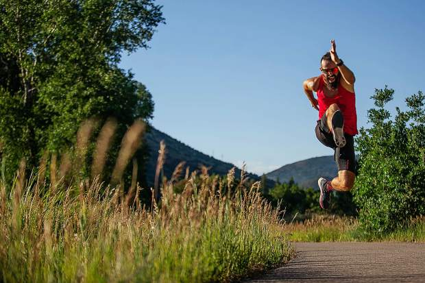 Jane Alexandru leaps in the air while competing in the Aspen Valley Marathon on the Rio Grande Trail on Saturday morning. Alexandru finished 25th overall in the full marathon.