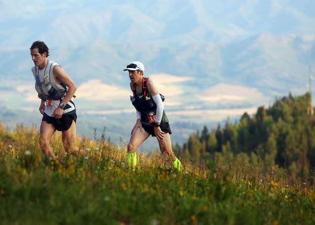 Joshua Eberly, left, and Ryan Bak climb Aspen Mountain during the Power of Four 50k trail run on Sunday, July 29, 2018. Both men were later disqualified for mistakenly going off course. (Photo by Austin Colbert/The Aspen Times).