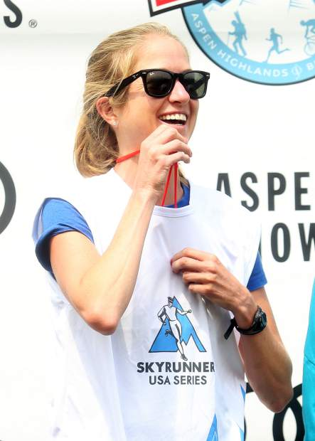 Boulder's Ginna Ellis stands on the podium after winning the women's Power of Four 50k trail run on Sunday, July 29, 2018. (Photo by Austin Colbert/The Aspen Times).