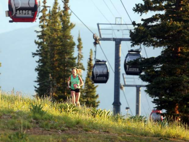 Ginna Ellis reaches the top of Aspen Mountain during the Power of Four trail run on Sunday, July 29, 2018. (Photo by Austin Colbert/The Aspen Times).