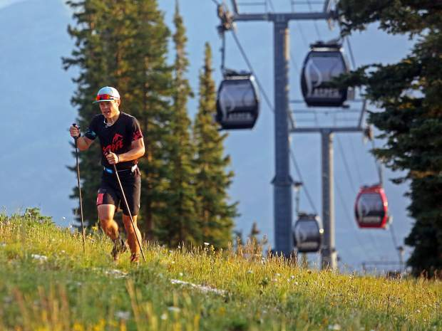 Max Taam reaches the top of Aspen Mountain just after sunrise during the Power of Four trail run on Sunday, July 29, 2018. Taam finished sixth overall in the 50k race and was the men's three-event Triple Crown winner. (Photo by Austin Colbert/The Aspen Times).