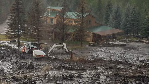 A mudslide onto Ace Lane's property threatened a structure on Saturday. Work with an excavator and other equipment diverted the debris.