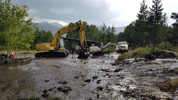 Excavating on the Lane Tree Farm property on a recent day after a storm creating a mudslide on the Lake Christine Fire burn scar on Saturday in El Jebel.