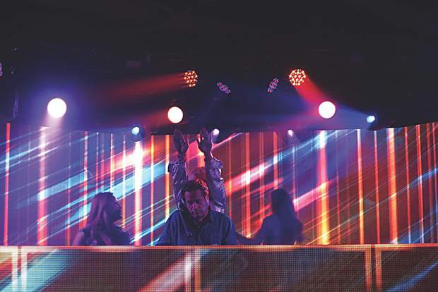 DJ John Jellybean Benitez spins for AfterPartyCrush, surrounded by a few friends onstage. May Selby photo.