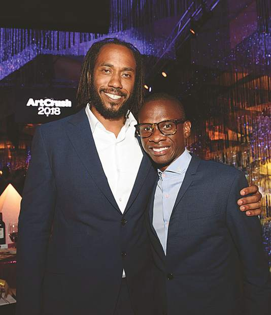 Rashid Johnson who was recognized with the 2018 Aspen Award for Art, with arts patron Troy Carter who purchased Johnson's piece in the live auction. MarySue Bonetti photo.