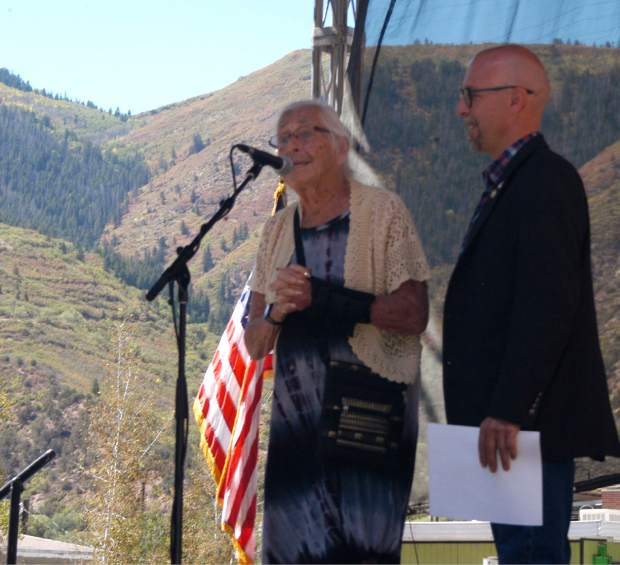 Marian Melville and her son Craig Melville speak Saturday about the family's commitment to maintain the legacy of the historic Hotel Colorado, during the combined 125th birthday party for the hotel and the nearby Yampah Spa and Vapor Caves.