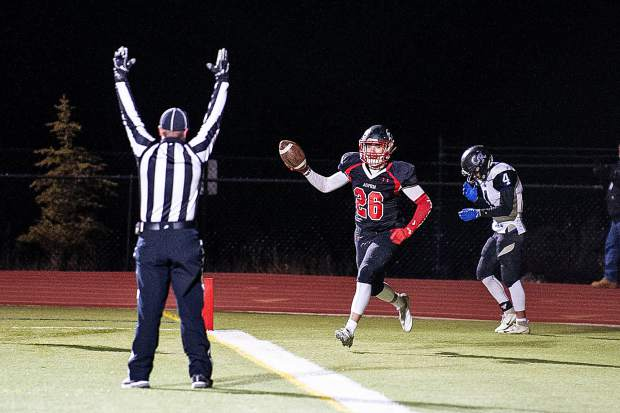 Max Ufkes after scoring a touchdown at the homecoming game versus Coal Ridge Friday night.
