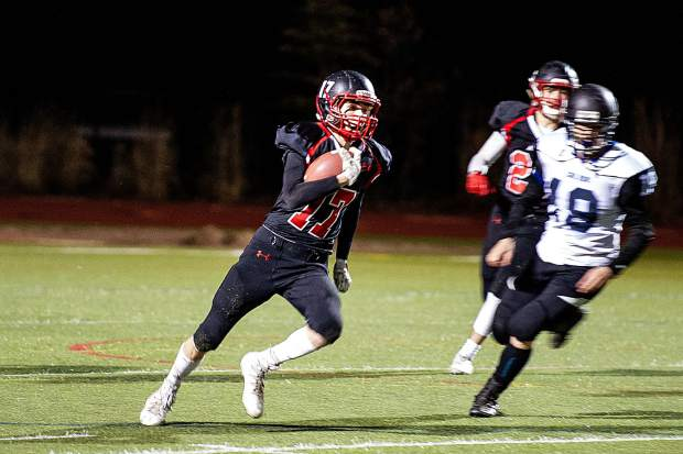 Noah Hollander makes a carry for the Aspen Skiers versus Coal Ridge Friday night for their homecoming football game.
