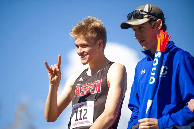 Aspen High senior Nicholas Galambos signals to the crowd at the state regional cross country meet at the Aspen Golf Course on Friday morning. Galambos took 9th overall.
