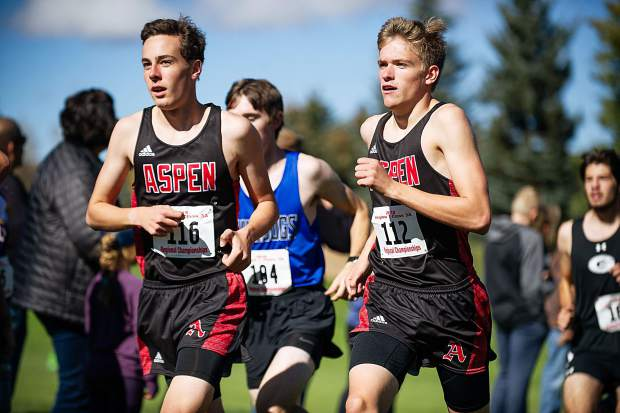 Aspen High seniors Everett Olson, left, and Nicholas Galambos running at the state regional cross-country meet at the Aspen Golf Course on Friday morning. Olson took 5th while Galambos claimed 9th.