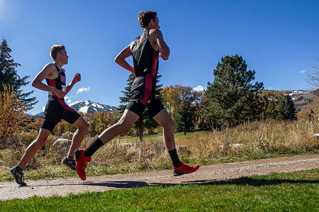Aspen High seniors Everett Olson, right, and Nicholas Galambos running at the state regional cross-country meet at the Aspen Golf Course on Friday morning. Olson took 5th while Galambos claimed 9th.