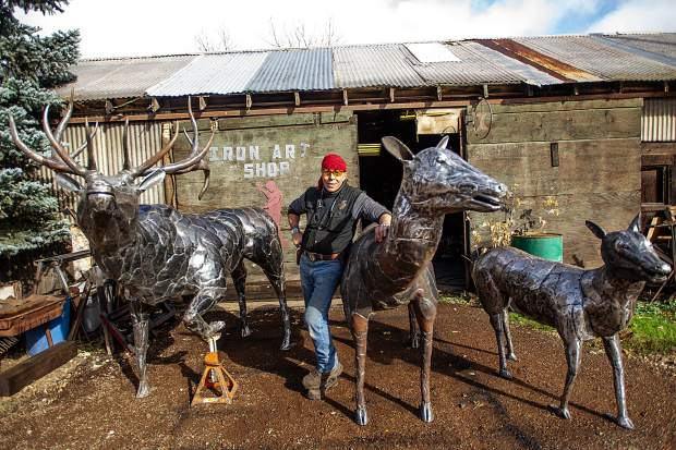 El Jebel Blacksmith Vaughn Shafer poses with three elk he and sculptor Thomas Barlow were commissioned to make for the El Jebel roundabout.