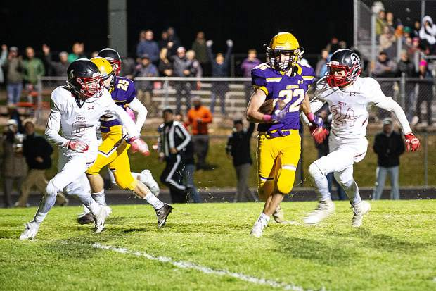 Jake Reardon, center, carries the ball for a touchdown for Basalt in the home game versus Aspen on Friday night. Basalt won 27-6.