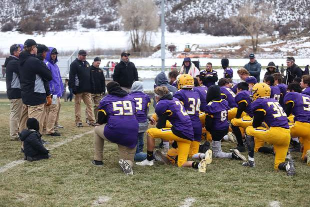 Basalt football players and coaches talk after a loss against Platte Valley in the 2A state quarterfinals on Saturday, Nov. 10, 2018, in Basalt. (Photo by Austin Colbert/The Aspen Times).
