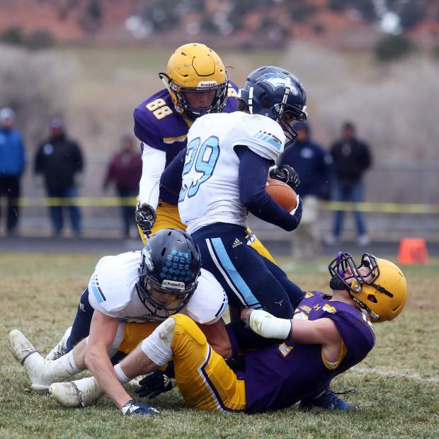 Basalt player Jackson Rapaport brings down a Platte Valley runner in the 2A state quarterfinals on Saturday, Nov. 10, 2018, in Basalt. (Photo by Austin Colbert/The Aspen Times).