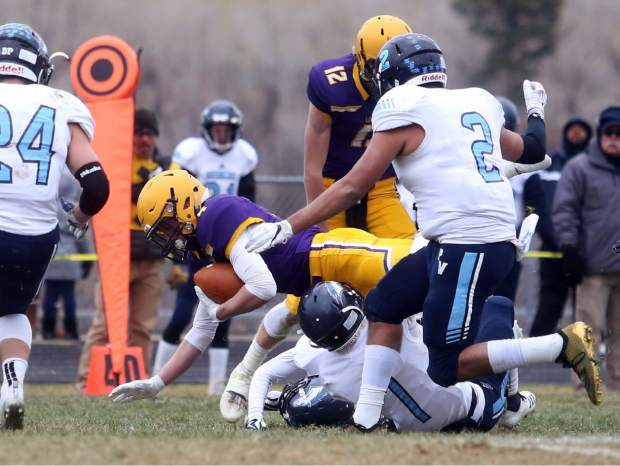 Basalt running back Cole Dombrowski dives for a first down against Platte Valley in the 2A state quarterfinals on Saturday, Nov. 10, 2018, in Basalt. (Photo by Austin Colbert/The Aspen Times).
