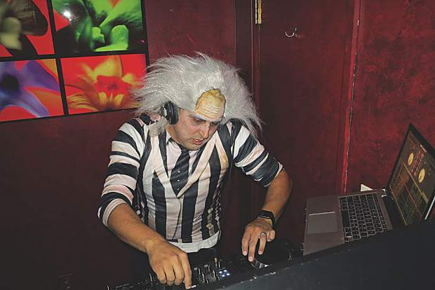 Beetlejuice in the DJ booth at the Caribou.
