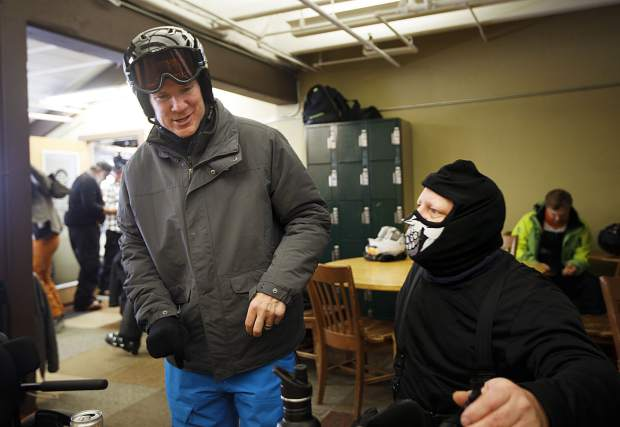 Colorado residents Tom Allind and Gary Verrazano chat as they prepare to go skiing on Thursday, Jan. 17, at Keystone Resort.