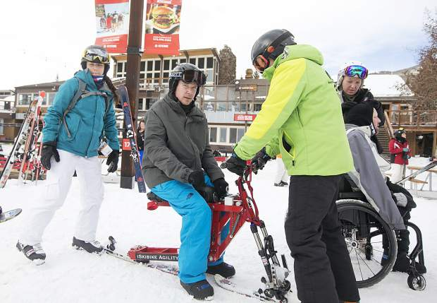 Parker resident Tom Allind gears up on his adaptive snowbike as he preparse to go skiing with help of guides on Thursday, Jan. 17, at Keystone Resort.