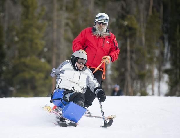 Gary Verrazano of Denver skis with the help of guide Chris Werhane (rear) on Thursday at Keystone Resort.