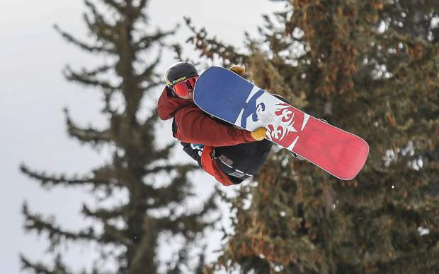 Chris Corning goes for a grab during the Slopestyle Qualifiers for the X-Games on Thursday, Jan. 25, in Aspen.