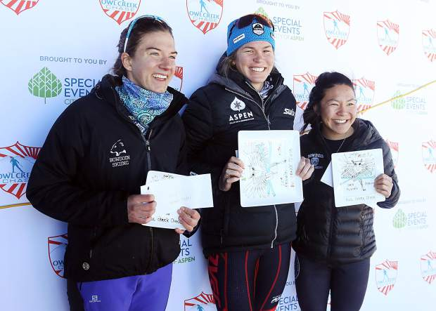 From left, women's classic race third-place finisher Hannah Miller, winner Kara LaPoint and runner-up Ellie Hands pose on the podium of the Owl Creek Chase cross-country ski race on Sunday, Feb. 10, 2019, at the Aspen Nordic Center. (Photo by Austin Colbert/The Aspen Times).