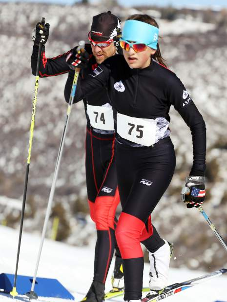 Aspen's Elsie Weiss, front, tries to outpace her father, Austin Weiss, to the finish line of the Owl Creek Chase cross-country ski race on Sunday, Feb. 10, 2019, at the Aspen Nordic Center. (Photo by Austin Colbert/The Aspen Times).