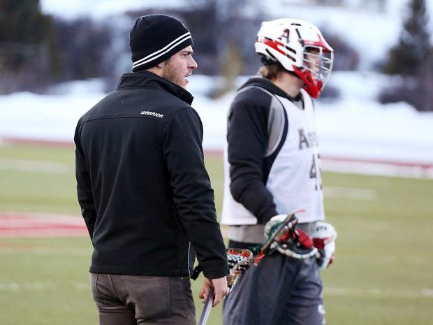 Aspen High School boys lacrosse coach Tommy Cox, left, watches during practice on Tuesday, Feb. 26, 2019, on the AHS turf.