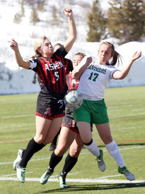 Players battle for the ball in the Aspen High School girls soccer game against Delta on Saturday, March 16, 2019, on the AHS turf. (Photo by Austin Colbert/The Aspen Times).
