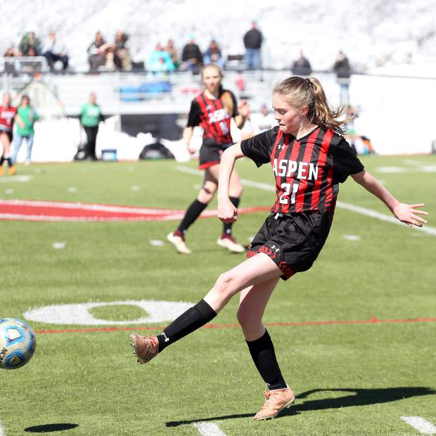 Aspen High School's Jennifer Ellis passes in the girls soccer game against Delta on Saturday, March 16, 2019, on the AHS turf. (Photo by Austin Colbert/The Aspen Times).