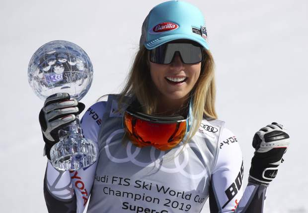 United States' Mikaela Shiffrin holds the women's World Cup super G discipline trophy, at the alpine ski World Cup finals, in Soldeu, Andorra, Thursday, March 14, 2019. (AP Photo/Alessandro Trovati)