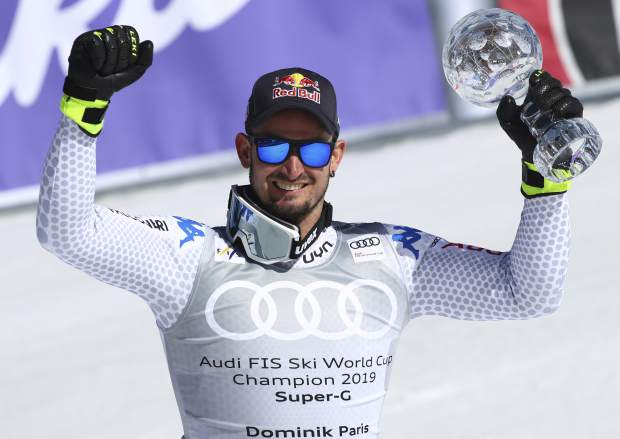 Italy's Dominik Paris holds the men's World Cup super G discipline trophy, at the alpine ski World Cup finals, in Soldeu, Andorra, Thursday, March 14, 2019. (AP Photo/Alessandro Trovati)