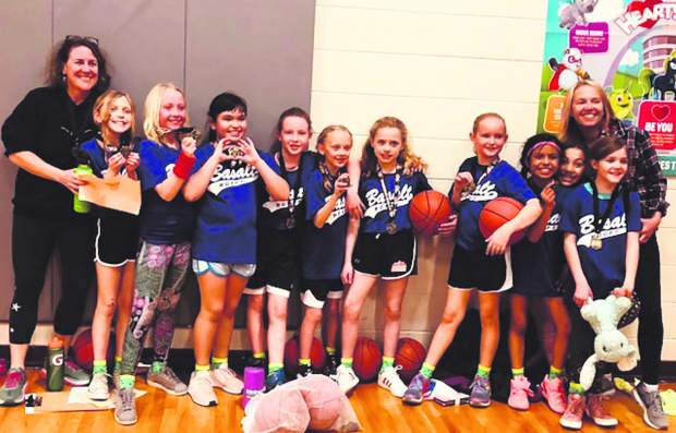 The Basalt third- and fourth-grade girls won the Roaring Fork Youth Basketball League on Feb. 28 in Basalt.  From left to right are coach Katie Fitzgerald, Teia Fryer, Macy Rowley, Natalie Chavarin, Spencer Irving, Sadie Gee, Greyson Miller, Lily Fitzgerald, Aymar Mellin, Emme Eads, Grace Campise and coach Kari Rowley.