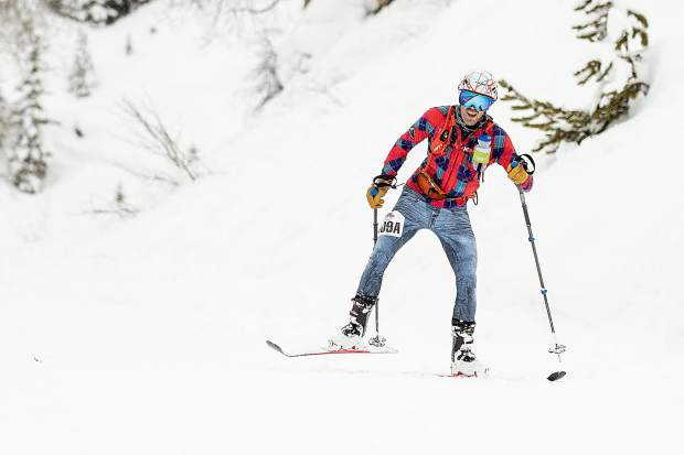 Frisco resident Hugh Carey skate skis uphill to keep up with race partner Sam O'Keefe, not pictured, during the final descent of the race,on Aspen Mountain, during the Audi Power of Four ski mountaineering race on March 2, near Aspen.