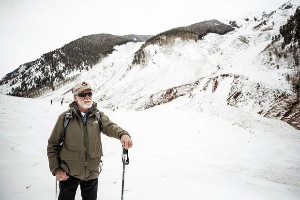 Art Mears, a top consultant on avalanche avoidance and mitigation in the U.S., checks out the slide path in Conundrum Creek Valley on Tuesday.