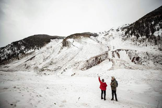 Avalanche expert Art Mears and his wife, Paula Lehr, check out the avalanche path that started on Highlands Ridge.