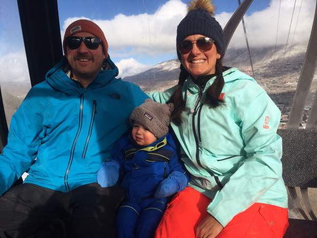 Shaun, Cooper and Lindsay Cagley ride the Silver Queen gondola at Aspen Mountain at the beginning of the ski season.