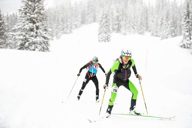 Cam Smith, front, and Tom Goth compete in the ski mountaineering race, Power of Four, on Richmond Ridge of Aspen Mountain on Saturday. Smith and Goth took second place.